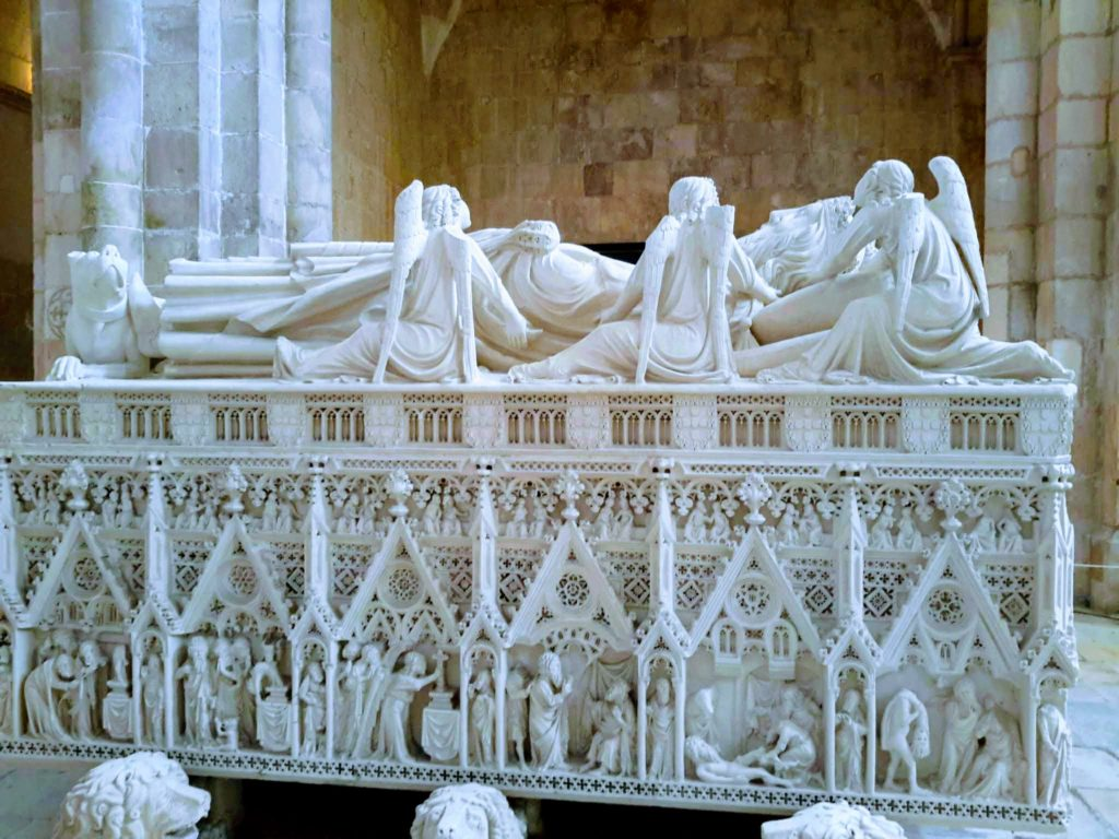 The Tomb of Pedro I with his statue of angels Alcobaca Monastery Portugal @DownshiftingPRO